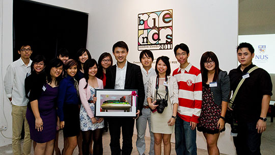 Photograph of the Random Blends 2011 committee members and the guest of honour, Mr Baey Yam Keng, taken on the opening night of the exhibition held at Old School.