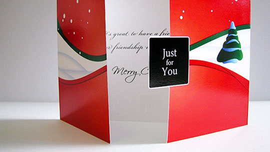 Photograph of an actual printed copy of the Just for You Christmas card.
