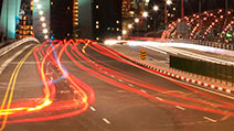 Photograph of motion blur light trails of vehicles moving towards Marina Bay Sands, Singapore.